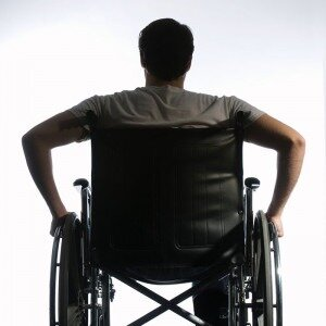 Back side of man in wheelchair