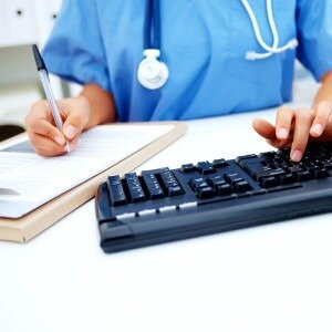 Medical person typing on keyboard