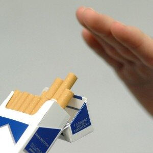 cigarette pack and hand